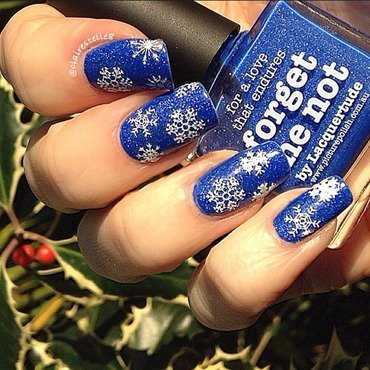 Forget Me Not and snowflakes nail art by Claire O'Sullivan
