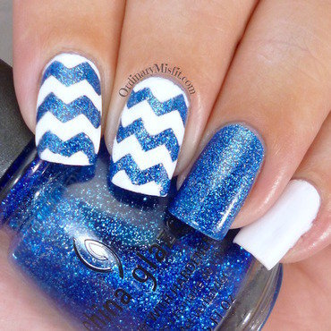 Glittery blue zig zags nail art by Michelle