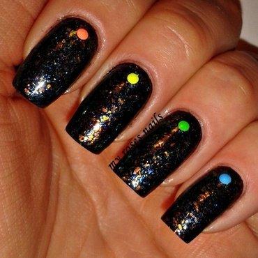 Flakies on black nail art by Ewa