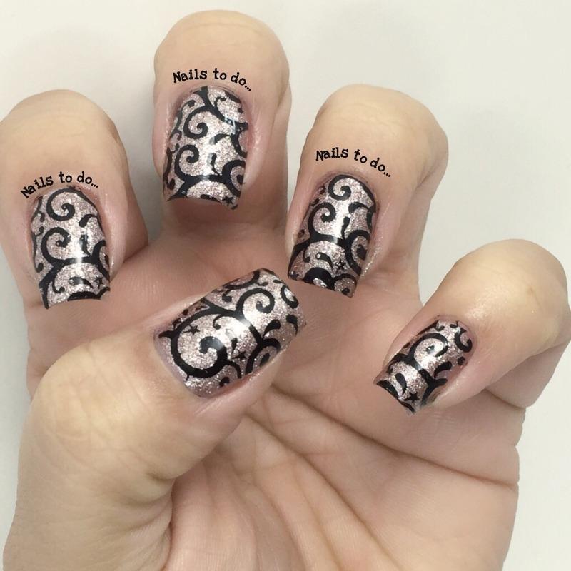 Glitter and black nail art by Jenny Hernandez
