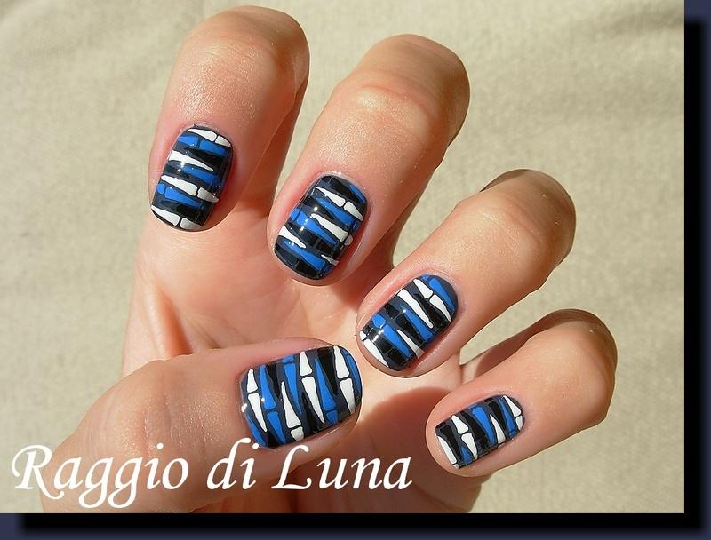 Black & white & blue flakes on grey blue nail art by Tanja