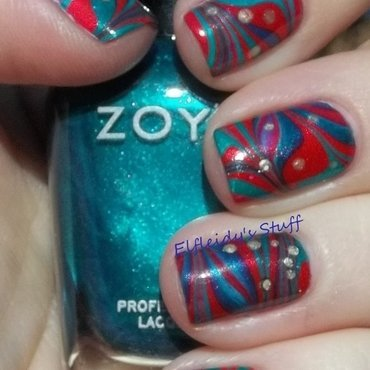 Red and green water marble nail art by Jenette Maitland-Tomblin