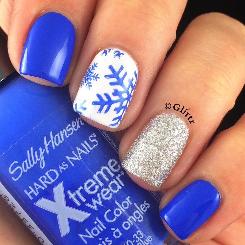 blue snowflakes nail art by Glittr