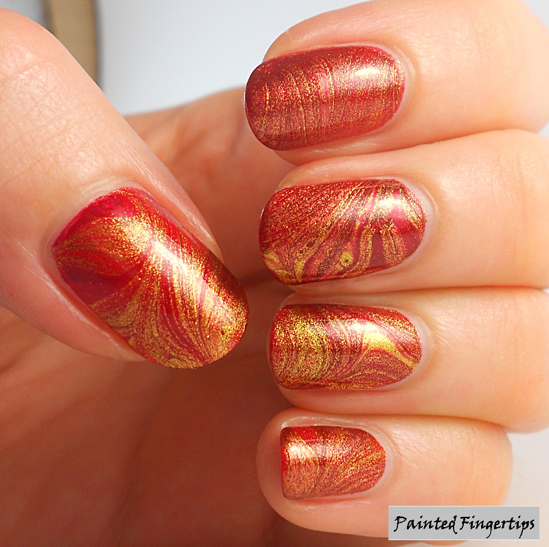 Red And Gold Water Marble Nail Art By Kerryfingertips Nailpolis