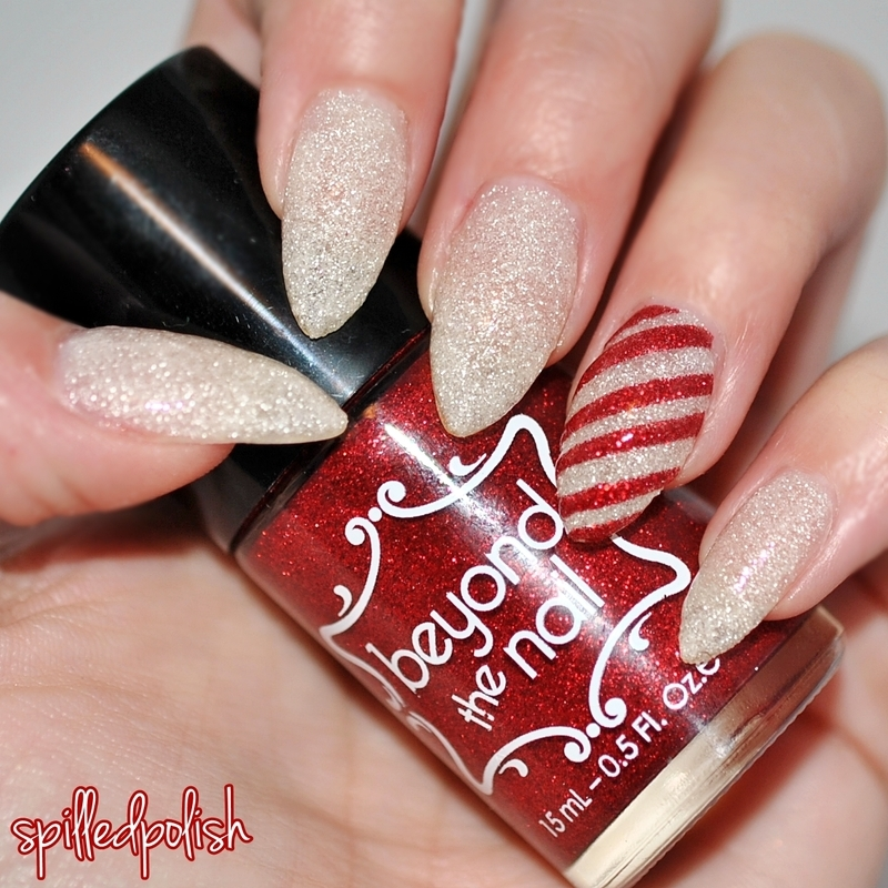 Candy Cane Accent Nail nail art by Maddy S