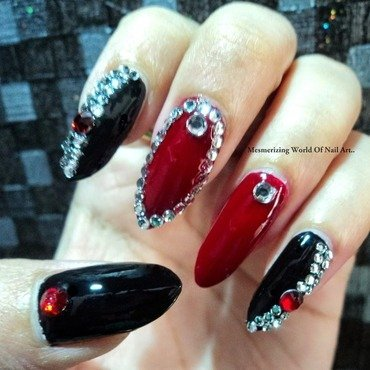 Red and Black Bling Stiletto Nails  nail art by Anubhooti Khanna