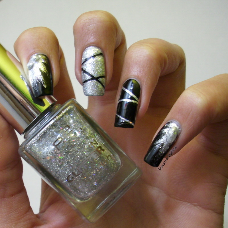 nye nails with silver glitter nail art by irma