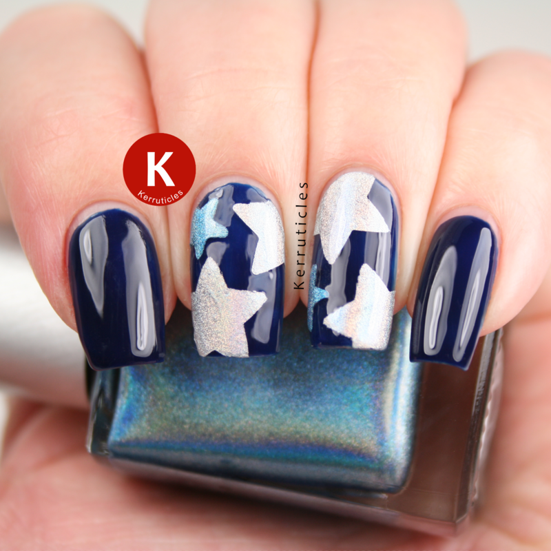 Holographic stars on navy nail art by Claire Kerr