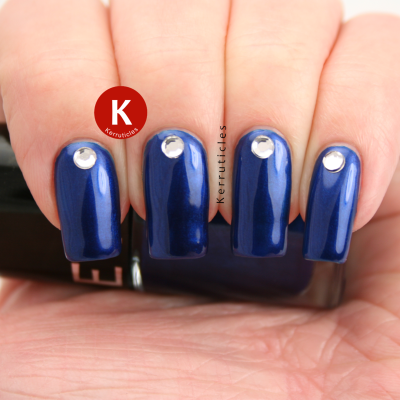 Metallic blue with rhinestones nail art by Claire Kerr
