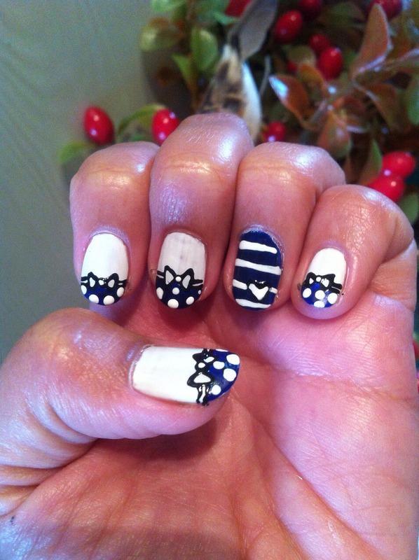 Bow nail art by Ruchi
