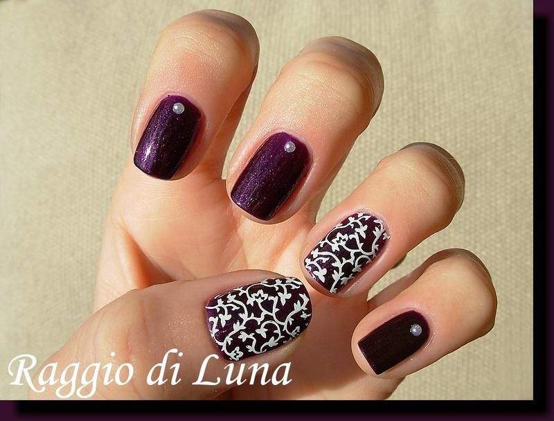 White leaf pattern on purple nail art by Tanja