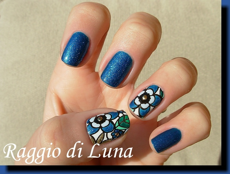 Blue flowers on tropic blue nail art by Tanja