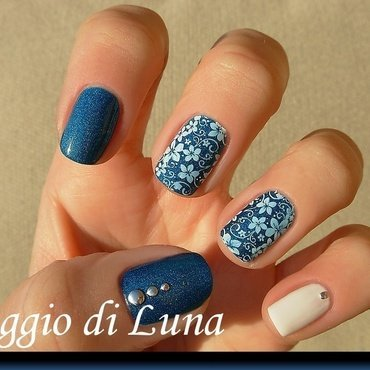 White flowers on blue skittlette nail art by Tanja