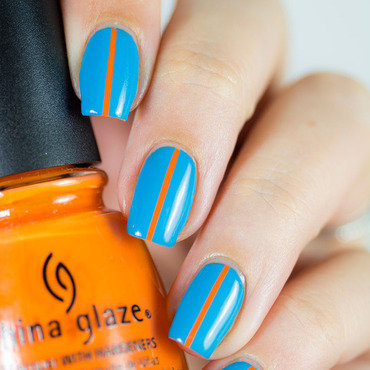 Bold colors & Striping Tape nail art by Dorra (didoline)