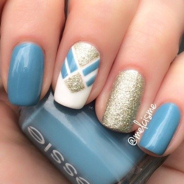 Blue/Gold tapemani nail art by Melissa