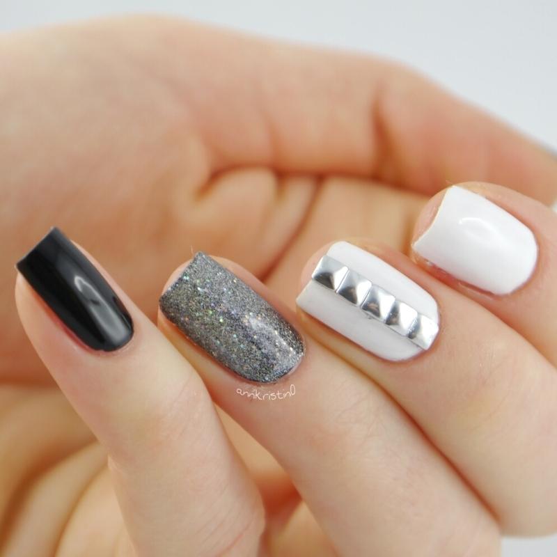 Edgy Black Studs nail art by Ann-Kristin