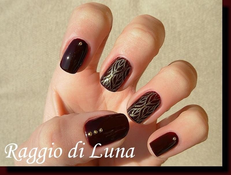 Golden stamping pattern on dark red nail art by Tanja