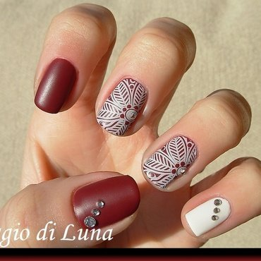 White stamping flowers on garnet red nail art by Tanja