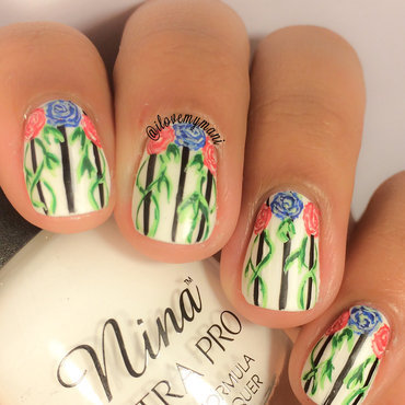 Hand painted stylized floral nail art! nail art by Gabrielle