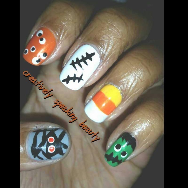 Friendly Halloween nail art by Kewani Granville