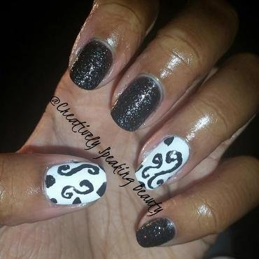 Swirls nail art by Kewani Granville