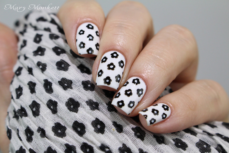 Black little flowers nail art by Mary Monkett
