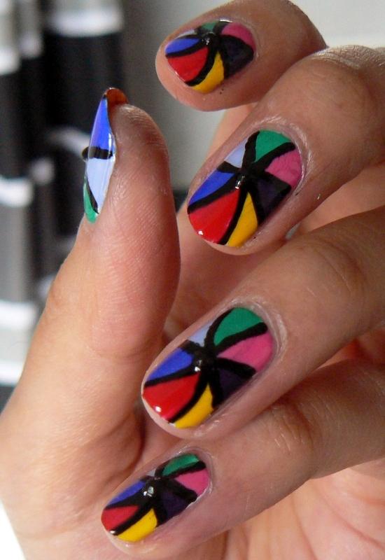 Rainbow Pinwheel nail art by Aysha Baig