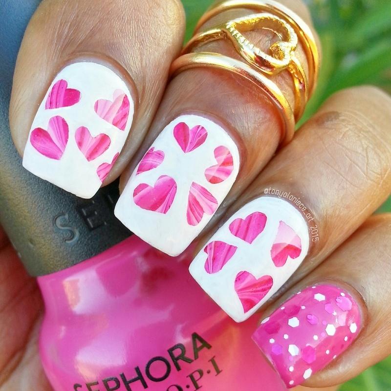 Watermarble Hearts nail art by Tonya