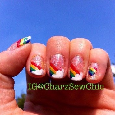 Rainbows and clouds nail art by Charlotte Speller
