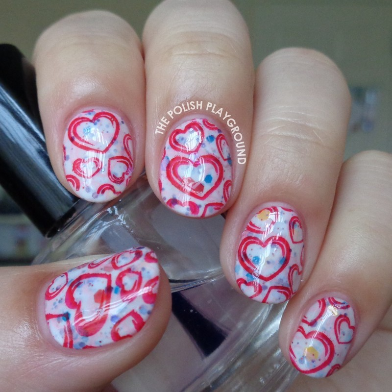 Double Stamped Pink and Red Hearts nail art by Lisa N
