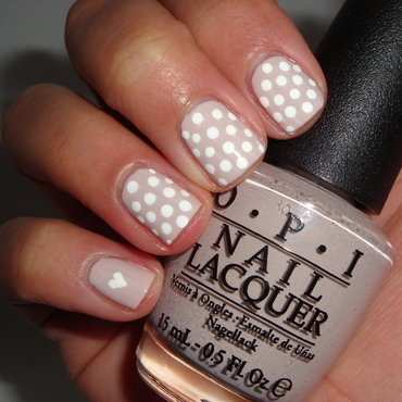 Polka dots and a heart nail art by Jessica