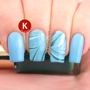 Blue and green water marble nail art by Claire Kerr