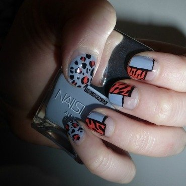 Blue Orange Animal Print nail art by The_Oracle