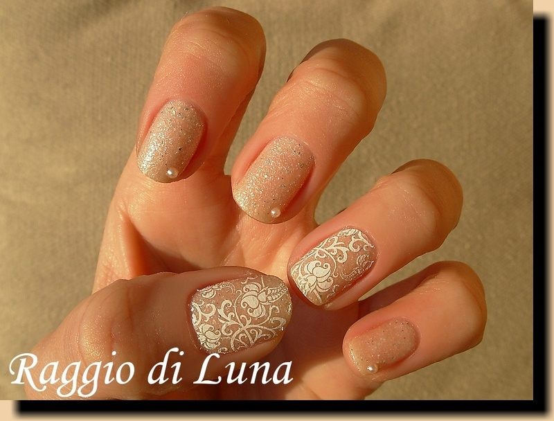 White bridal stamping manicure on textured nude nail art by Tanja