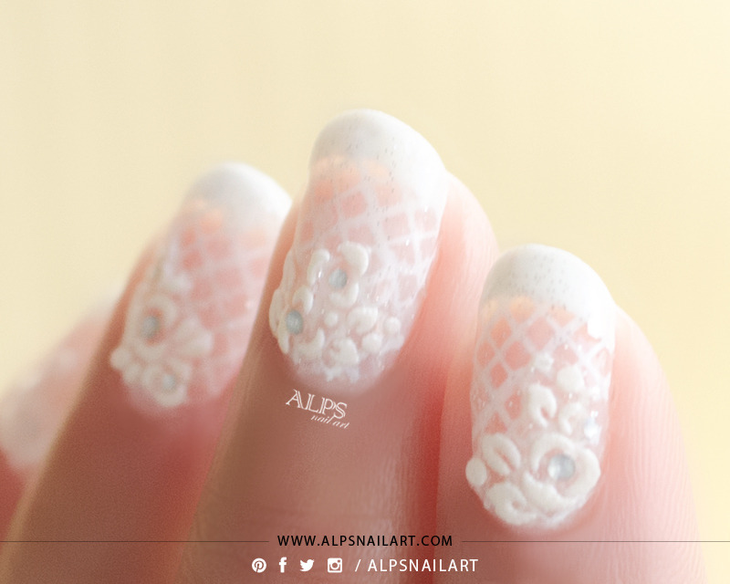 French Tip with lace Bridal nails by @alpsnailart nail art by Alpsnailart
