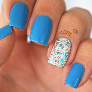 Blue + Silver Accent nail art by xNailsByMiri