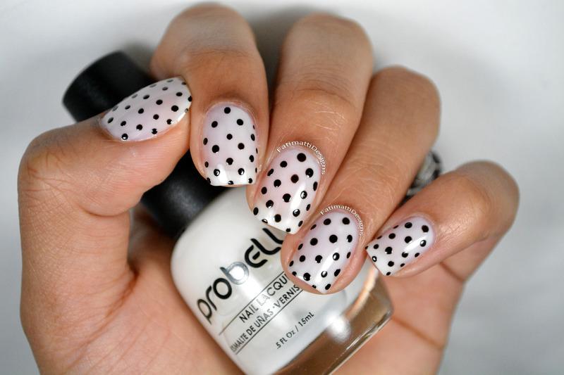 Black Polka Dots nail art by Fatimah