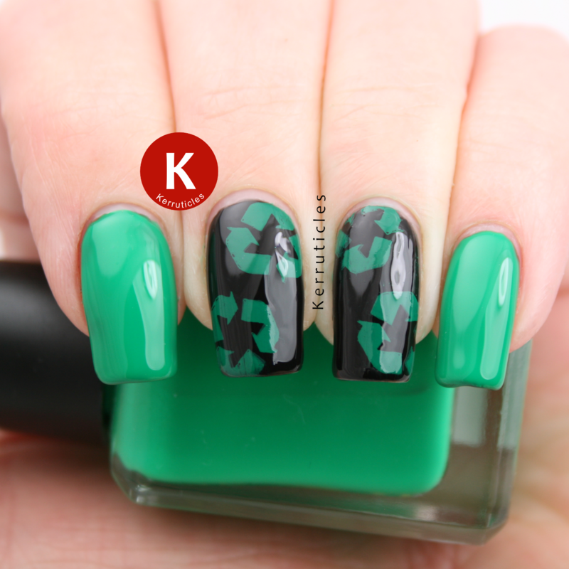Green and black recycling logo nail art by Claire Kerr