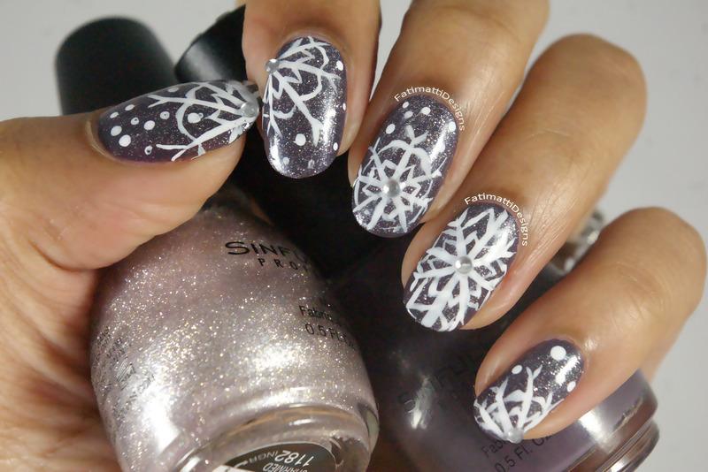 Marvelous Snowflake nail art by Fatimah