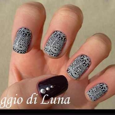 Stamping: White arabesque pattern on dark purple nail art by Tanja