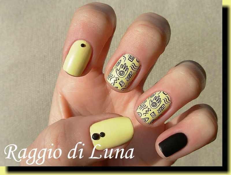 Stamping: Tribal black stamping on pastel yellow nail art by Tanja