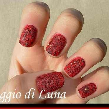 Stamping: Floral black pattern on textured red nail art by Tanja