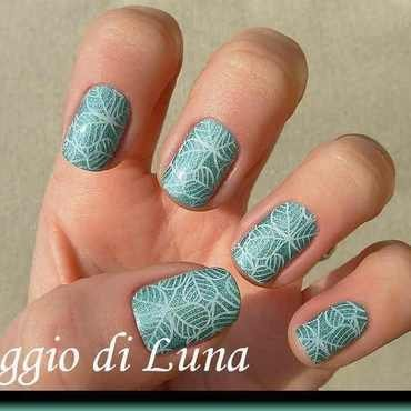 Stamping: Saint Patrick's Day shamrocks on holo green nail art by Tanja