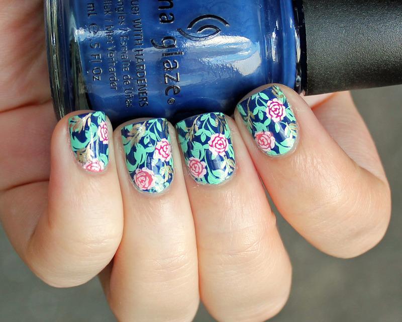 Blue + Flowers nail art by Moriesnailart