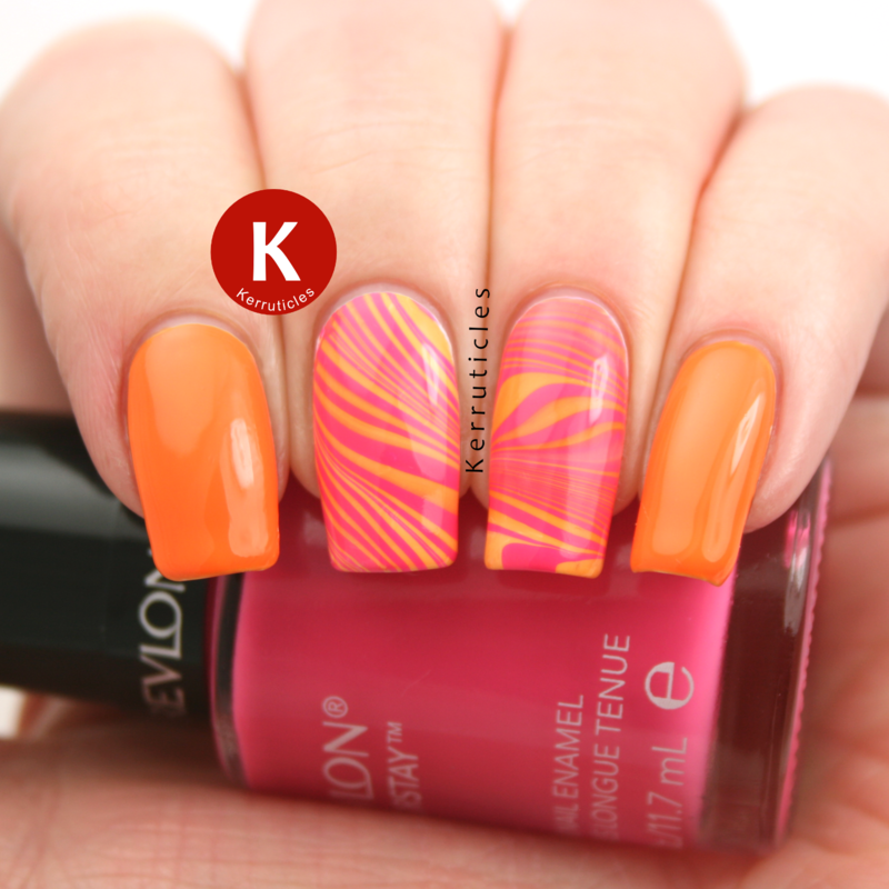 Pink and orange water marble nail art by Claire Kerr