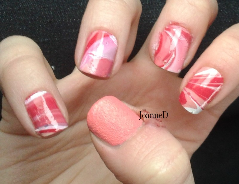 Pink water marble nail art by JoanneD