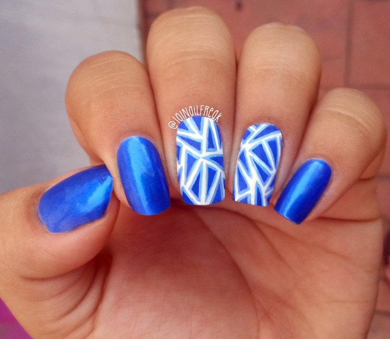 Electric Blue Triangles nail art by Selena  Lopez