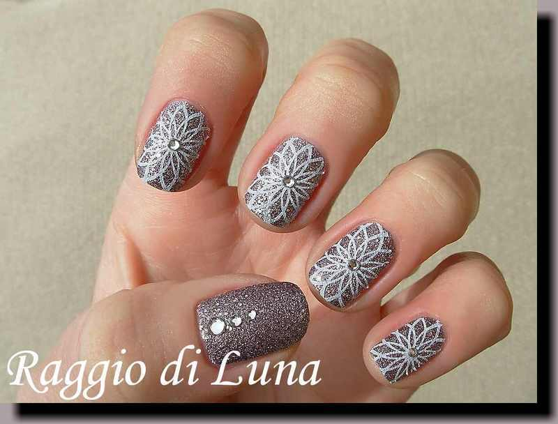 Stamping: White floral pattern on silver crystals nail art by Tanja