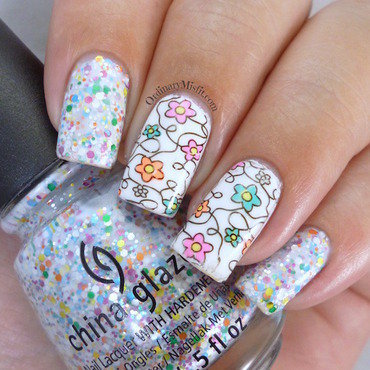 Flower doodles nail art by Michelle