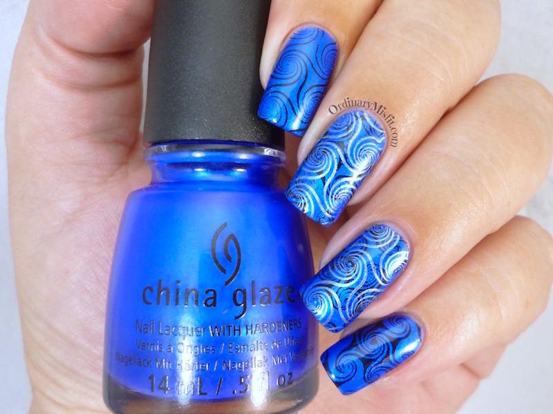 Blue swirls nail art by Michelle